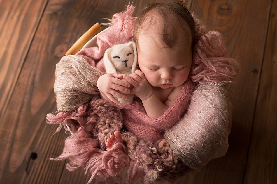 Baby girl in pink with little felt bunny